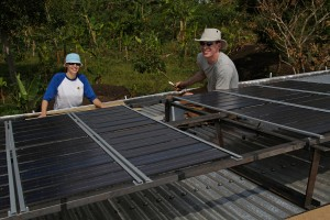Installing solar panels on the main building of the school