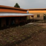 School construction completed with the outdoor kitchen moved from the central courtyard