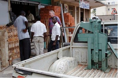 Ground Breaker brick making machine being purchased in Kampala