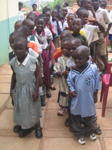 Saturday Club kids line up to receive new shoes for school