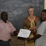 Teacher receiving completion certificate for teacher training