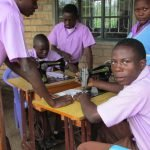 Student tailoring class - they typically learn to sew with paper first.